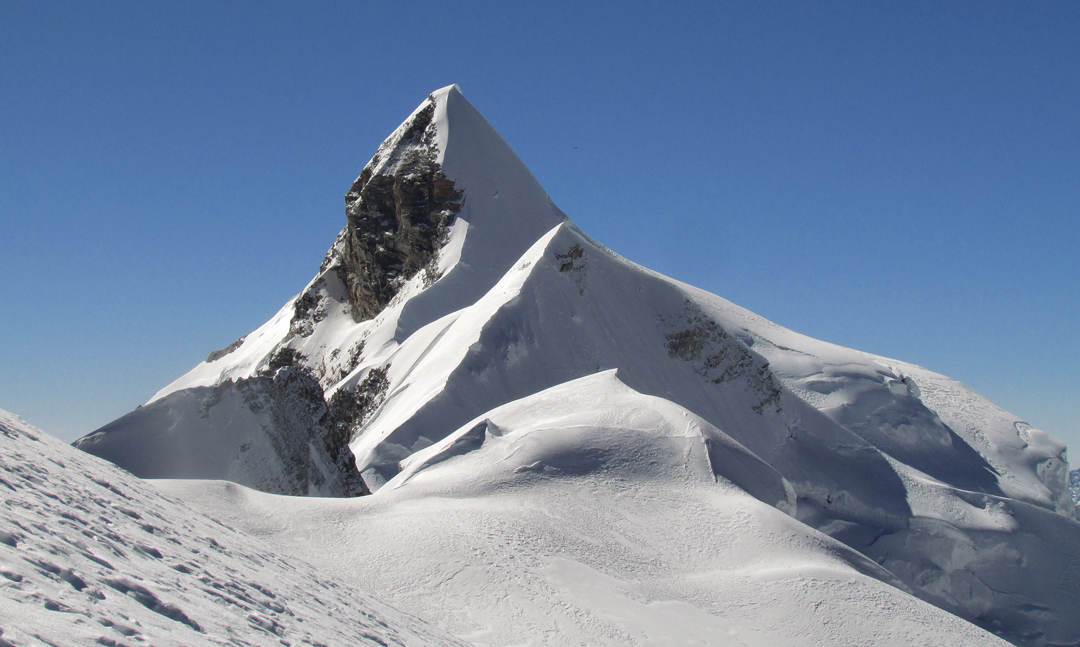 The main summit of Churau (6,419m), looking along its east ridge, the route of ascent.
