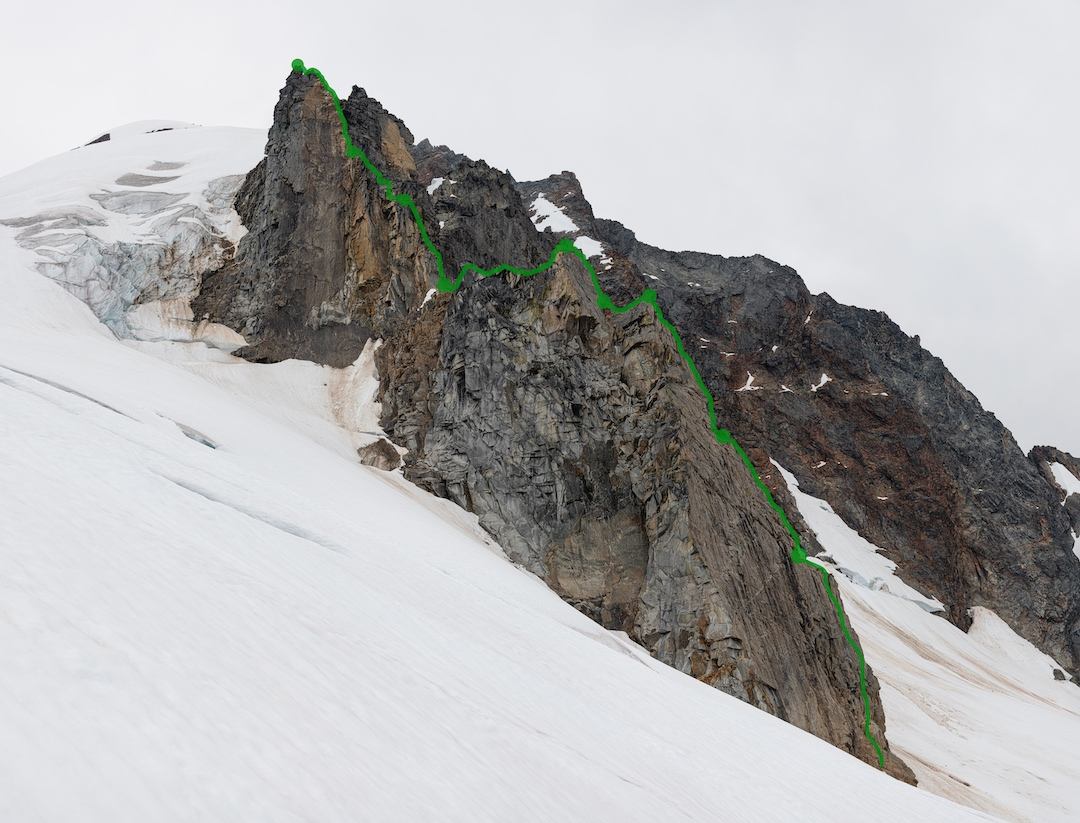 A panoramic shot of the route line for Klone Kalitan (5.8, 230m) on the west spur of Sahale Mountain in Boston Basin.
