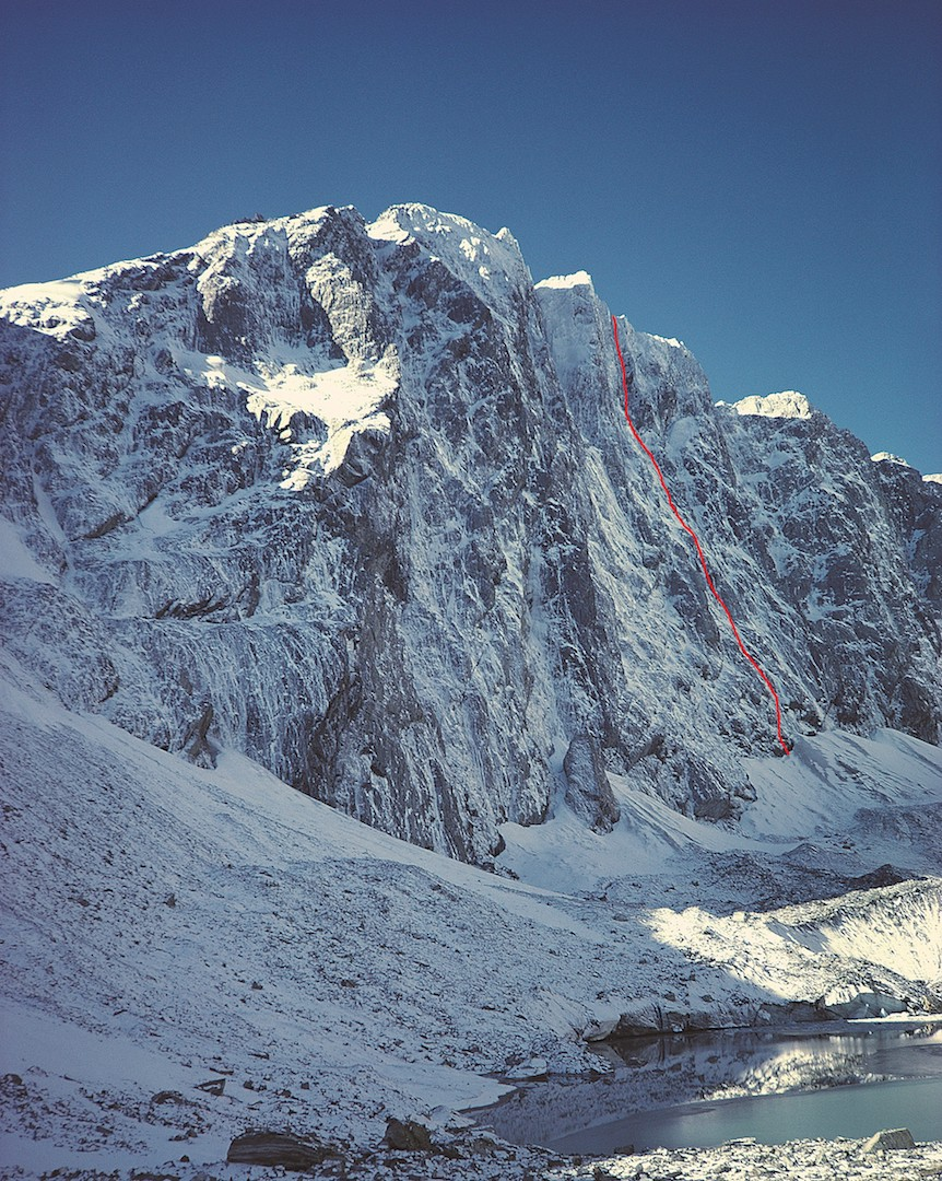 The southwest face of Mt. Percy Smith (2,465m) and the line of the Promise, soloed by Ben Dare in October 2018. The remote face is rarely seen in winter condition; this photo was taken in 1984. The only previous route is to the left: On the Dark Shore (790m, 23 pitches, with a crux of 17/5.9, Dickinson-McLeod, 1993).