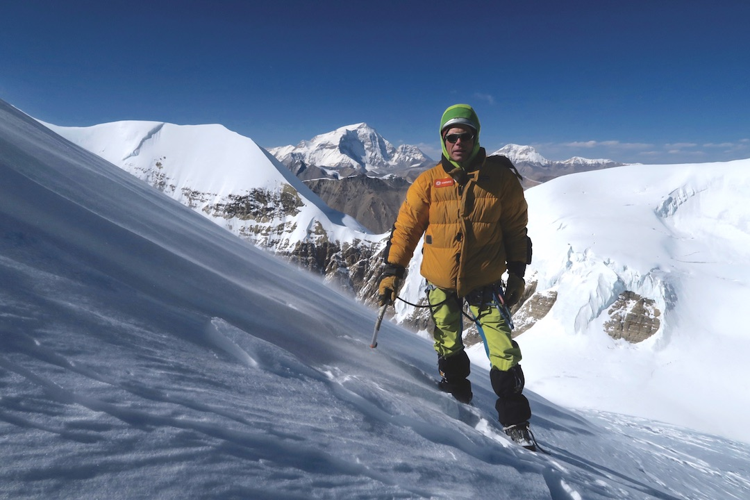 "The ""supremely energetic"" Bruce Normand on Til Kang, with Gurla Mandhata (7,694m) far back."