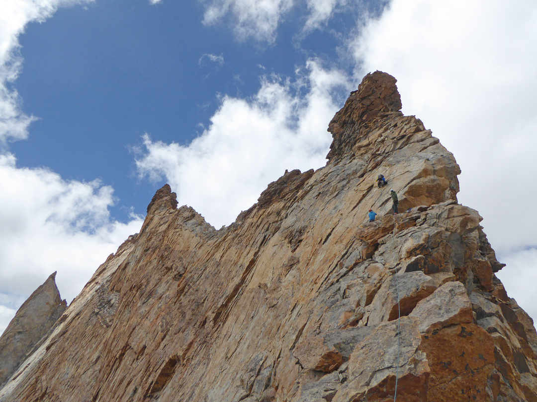 Italian climbers nearing the north summit of Chareze Ri (the higher tower to the left). An attempt to cross the knife-edge connecting ridge to the main summit beyond was foiled by darkness.