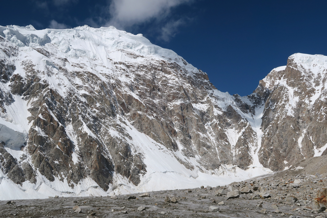 The serac-threatened north face of unclimbed Peak 6,316m (left) at the head of the First Virjerab Glacier. A passage of the obvious col would lead to the North Sekrwar Glacier and then southwest to the Khurdopin Glacier.