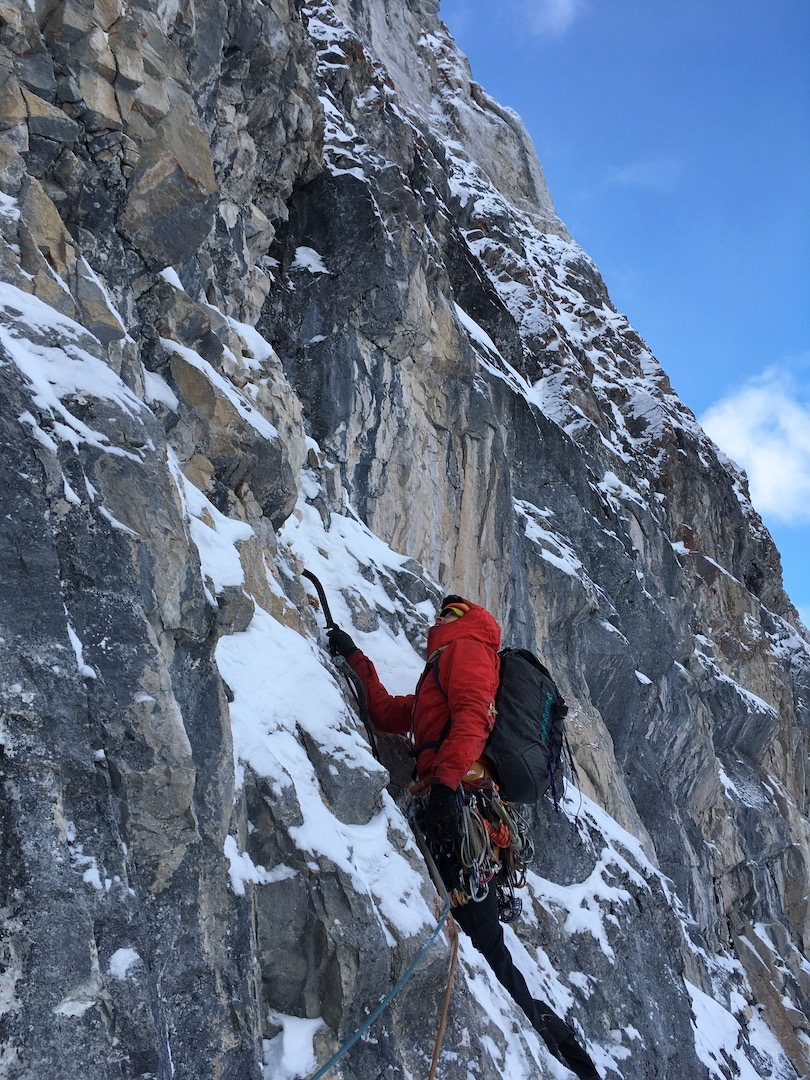 Niall Hamill leading a pitch of M6 R on Canmore Swingers Party (300m, WI3 M6+ R), a new line on the north face of Mt. Lawrence Grassi.