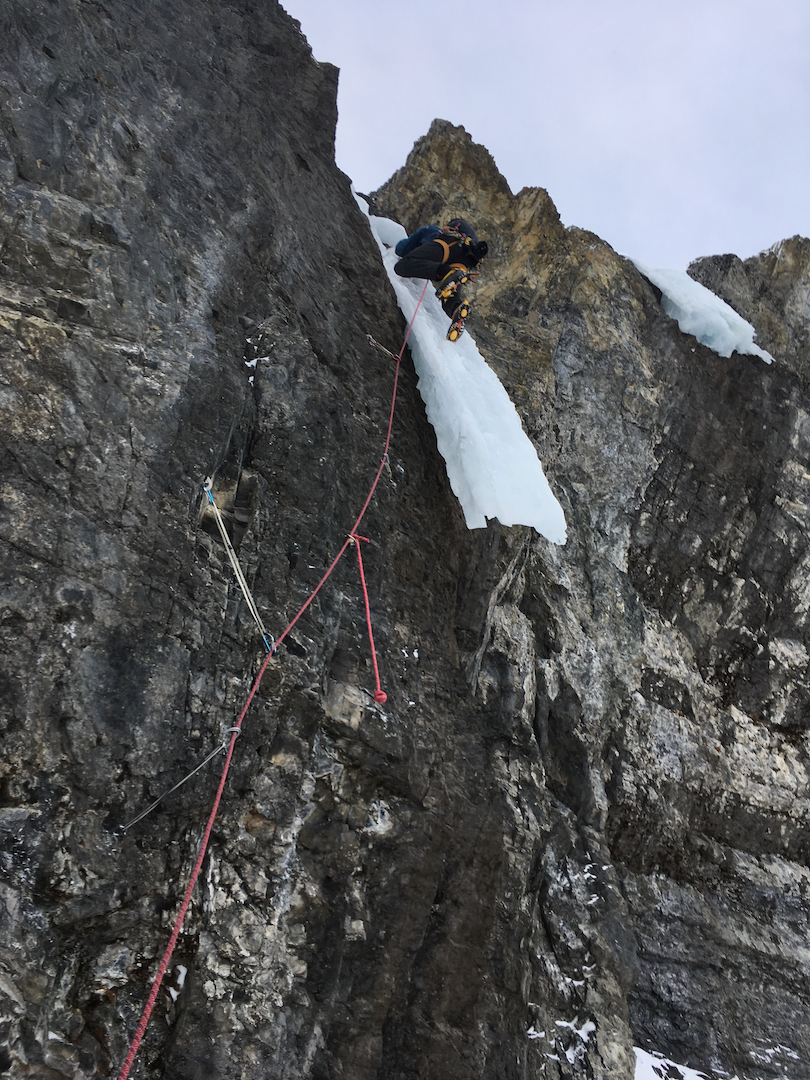 Niall Hamill leading up Canmonix Sit Start (170m, WI5 M7), which accesses Tainted Love and Canmore Swingers Party on the north face of Mt. Lawrence Grassi.