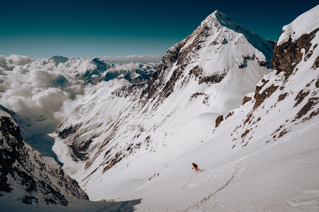 Hilaree Nelson exiting the Lhotse Couloir during the first ski descent, with Everest behind.