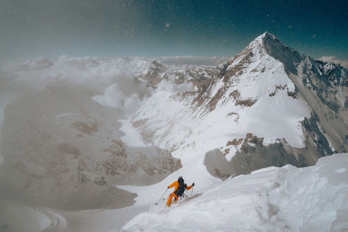 Jim Morrison drops off the summit of Lhotse. Deep snow allowed careful hop turns until a small cliff band, which he shot directly over to reach easier terrain.
