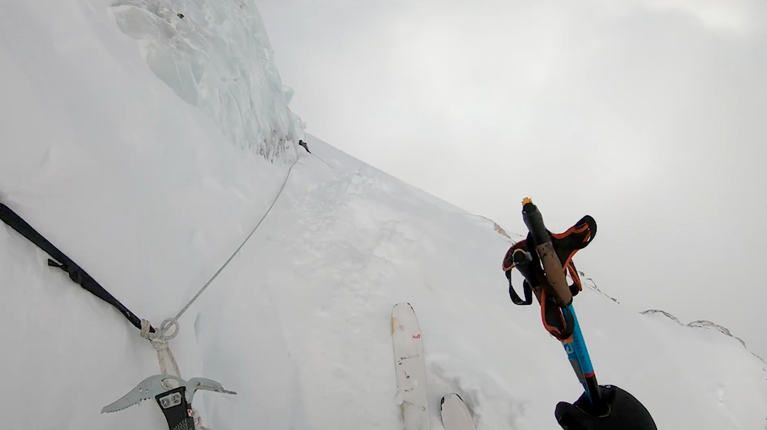 Alongside the fixed ropes through the Bottleneck on the Abruzzi Ridge. In some spots, Bargiel skied with both poles in one hand and an ice tool in the other for security.