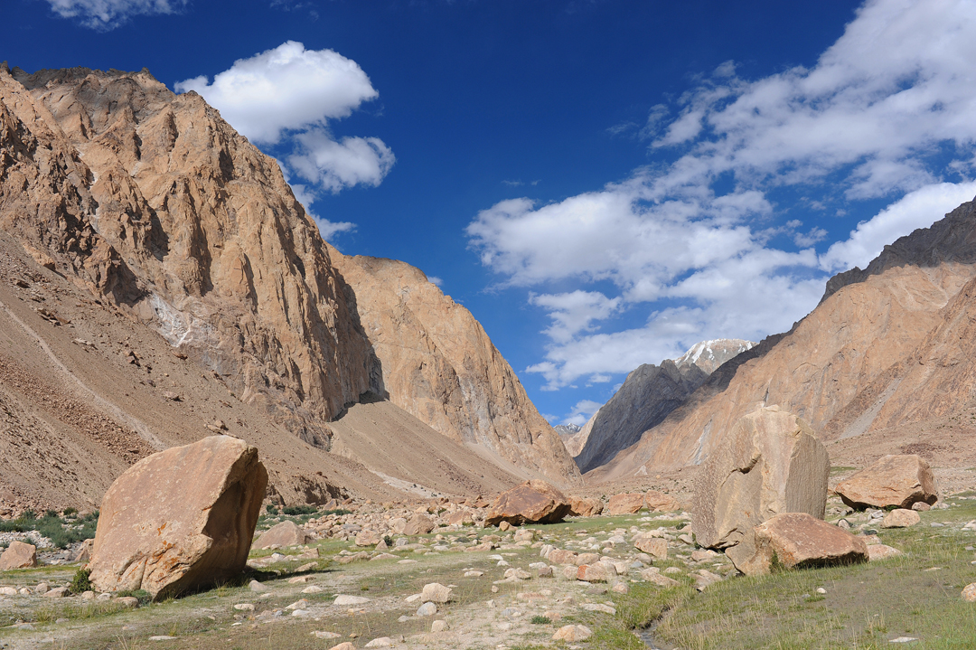 The meadows at Thipti in the Rongdo Valley, where the surrounding granite walls hold much potential for new rock routes.