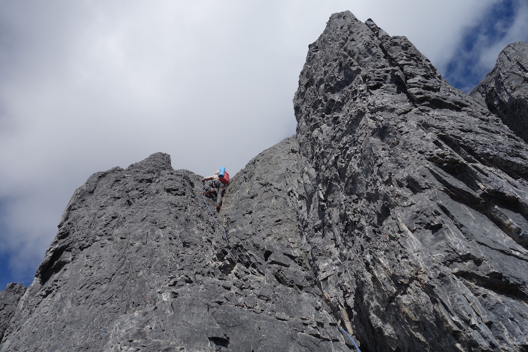Ian Welsted 150 meters below the shoulder of the Twins Tower, leading on crumbly rock during the first full ascent of the north ridge of North Twin.