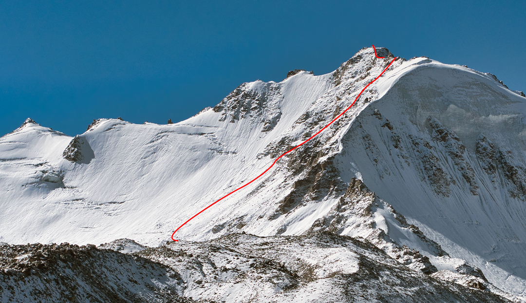 Rubtsak Koh (5,227m) above the Oktaliok Valley, seen from the northeast during the approach, with the line of Days That Will Last for Years on the east face.