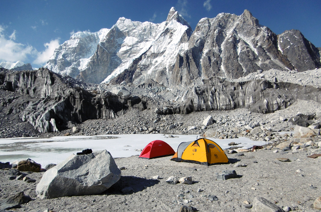 Base camp on the Khangri Nup Glacier. In the background lie subsidiary summits on the long south ridge of Chombu (6,859m).