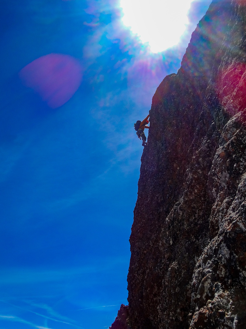 Max Fisher soloing 5.7 terrain near the top of the east face of Elkhorn Mountain (2,194m) during the first ascent of Horny Elk in June 2019.