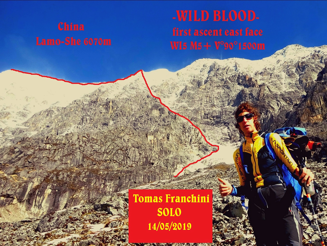 Tomas Franchini in front of Lamo-she and his route Wild Blood up the southeast face and northeast ridge.