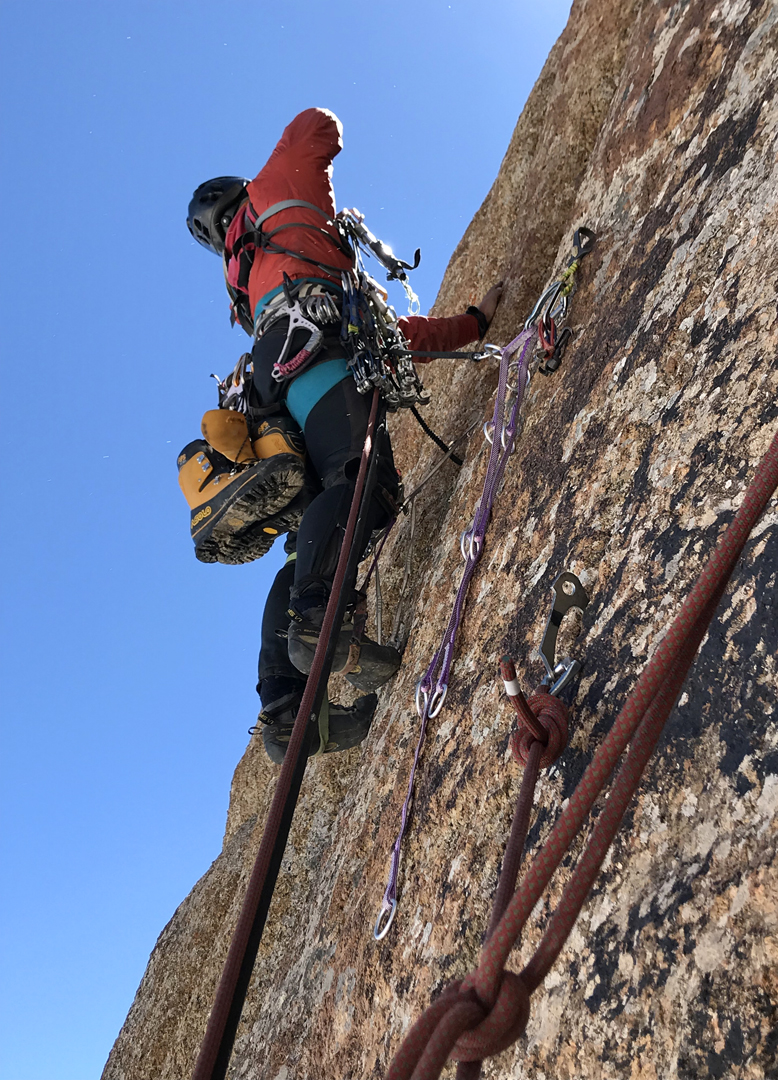 Ilya Penyaev climbing on skyhooks during the first ascent of the south pillar of Kyzyl Asker.
