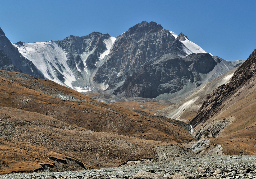 Looking up the Bel Uluu Valley toward the east flank of unclimbed Pik 5,080m.