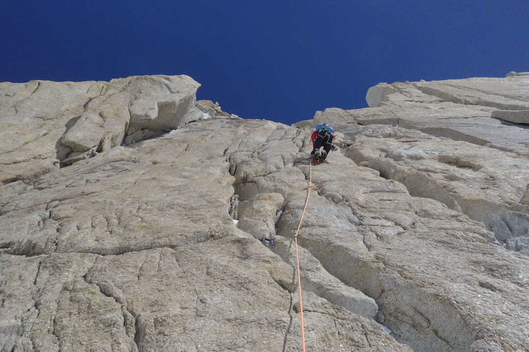 Astorga leading the A2 rock pitch at 15,100 feet, the key to the upper slopes of the south face.