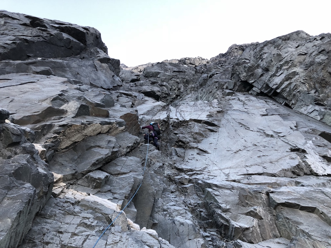 """Harrington starting up the west face of Devils Paw. A reconnaissance had revealed that, """"The mountain seemed compact and relatively sturdy, in contrast to the crumbling reputation I'd gathered from previous reports."""""""