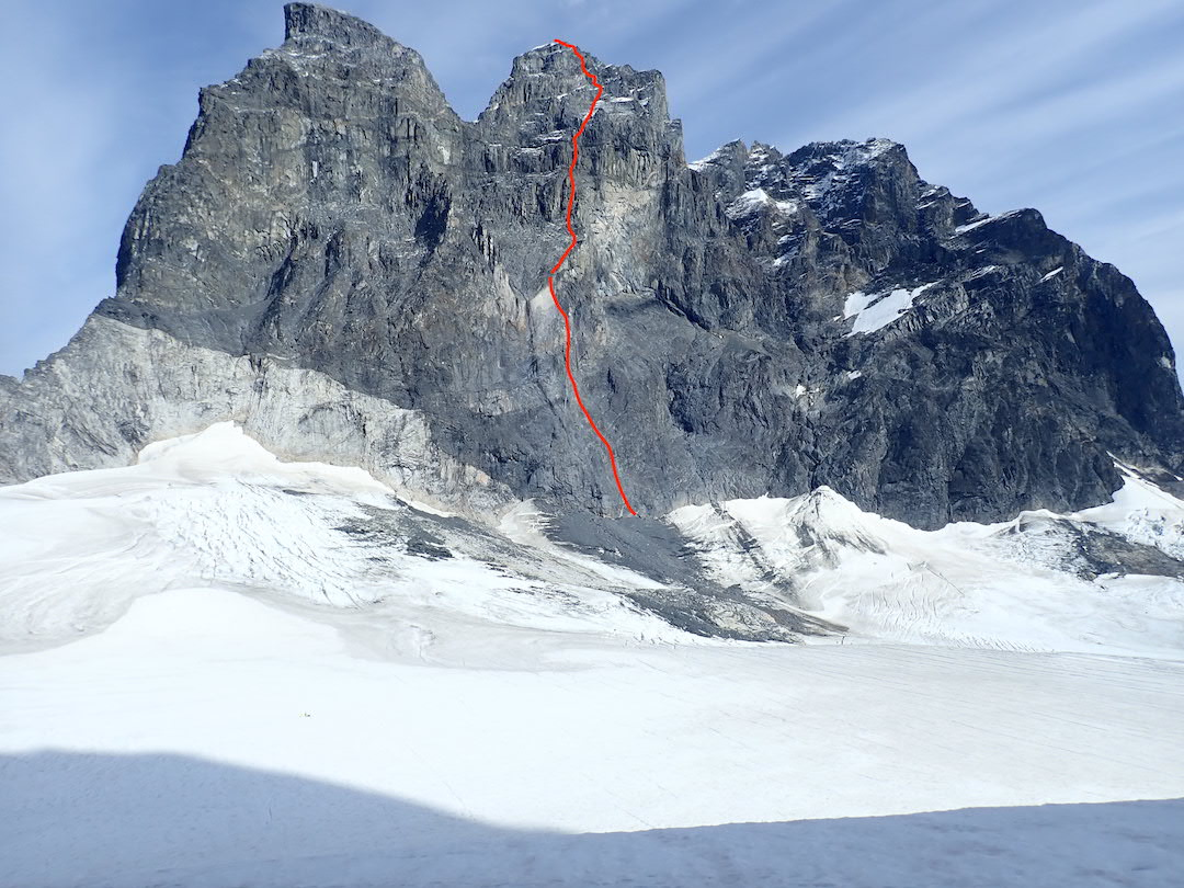 The line of Shaa Téix'i (ca 1,000m, 5.11a), the first route up the west face of Devils Paw's main summit. Although it appears taller from this angle, the northwest (left) top is lower.