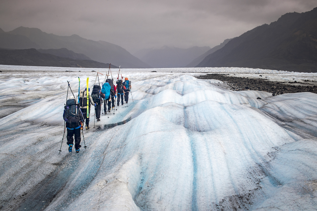 Participants in the Juneau Icefield Research Program crossing the Llewellyn Glacier in Canada, the last section of the program's six-week traverse over the icefield.