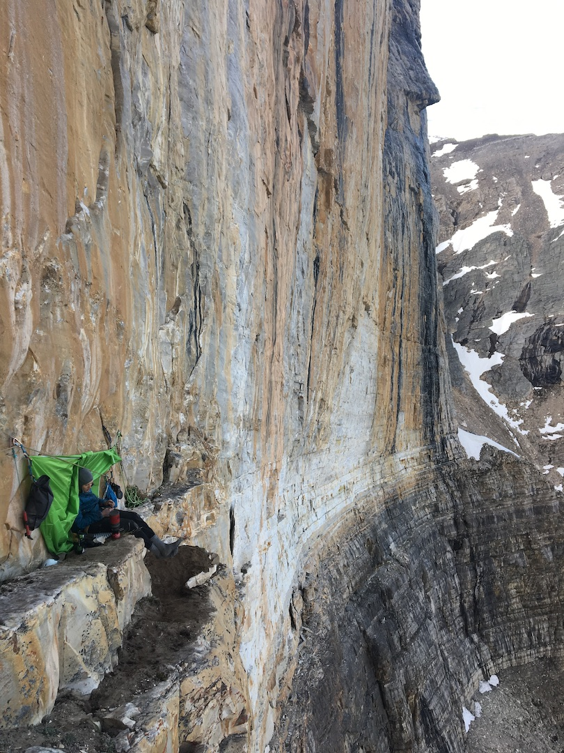 "Niall Hamill making the most of the ""perfect bivouac ledge"" he used to lure Ryan Richardson for a summer of new-routing on the southeast face of Peyto Tower."