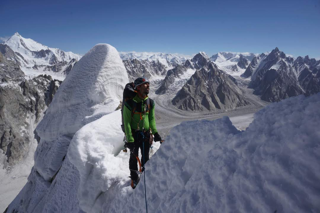 Luka Stražar pauses during the ascent of Latok I. The high peak in back left is Bobisghir (6,414m).