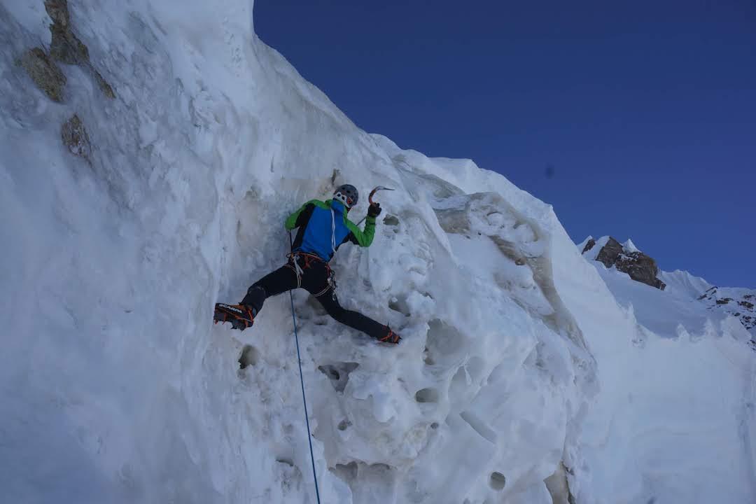 Luka Stražar climbing steep ice during the ascent of Latok I.
