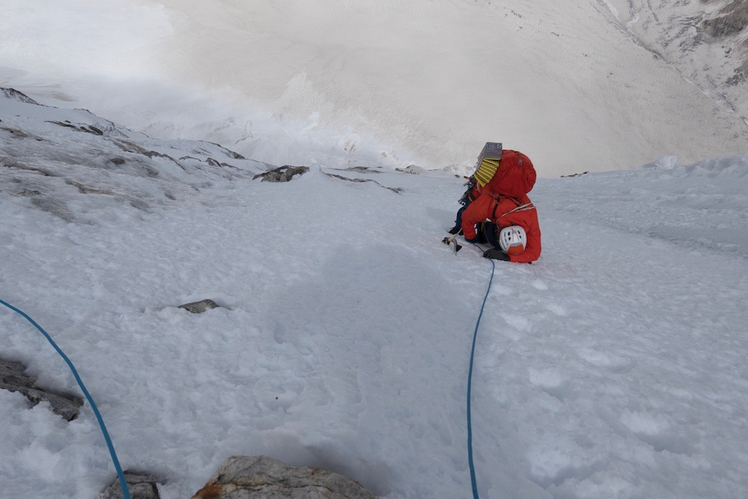 Tom Livingstone feeling the altitude at around 6,400 meters, headed toward the west col.