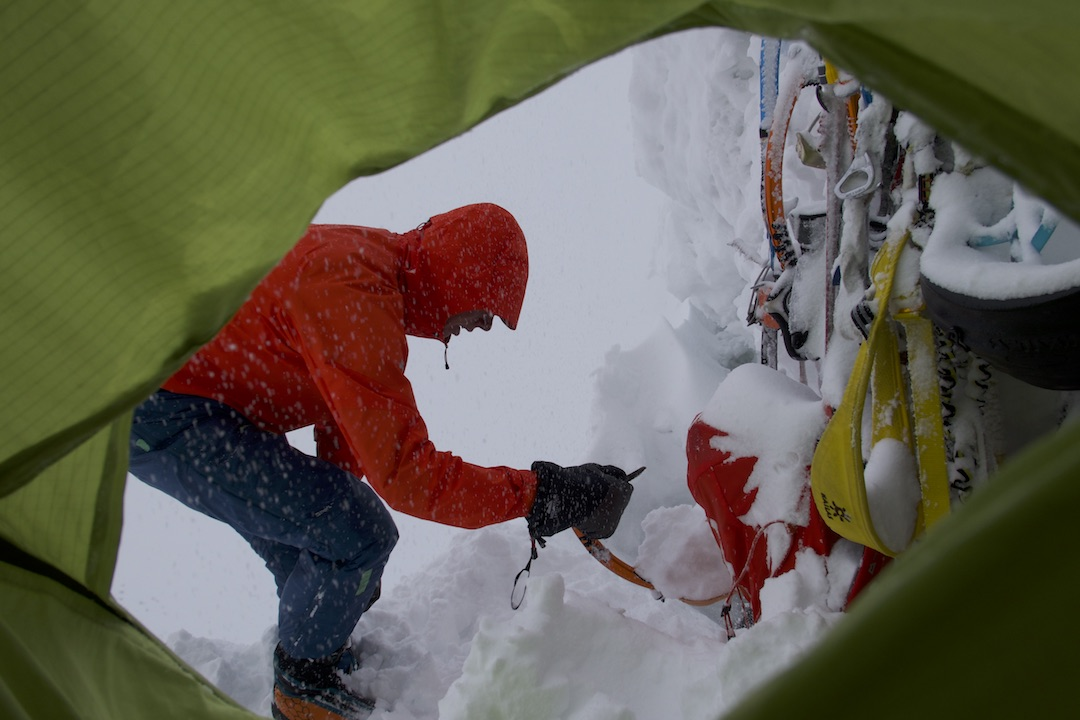 """Tom Livingstone digging out on the fifth morning of the climb. """"All thoughts of the summit had gone."""""""
