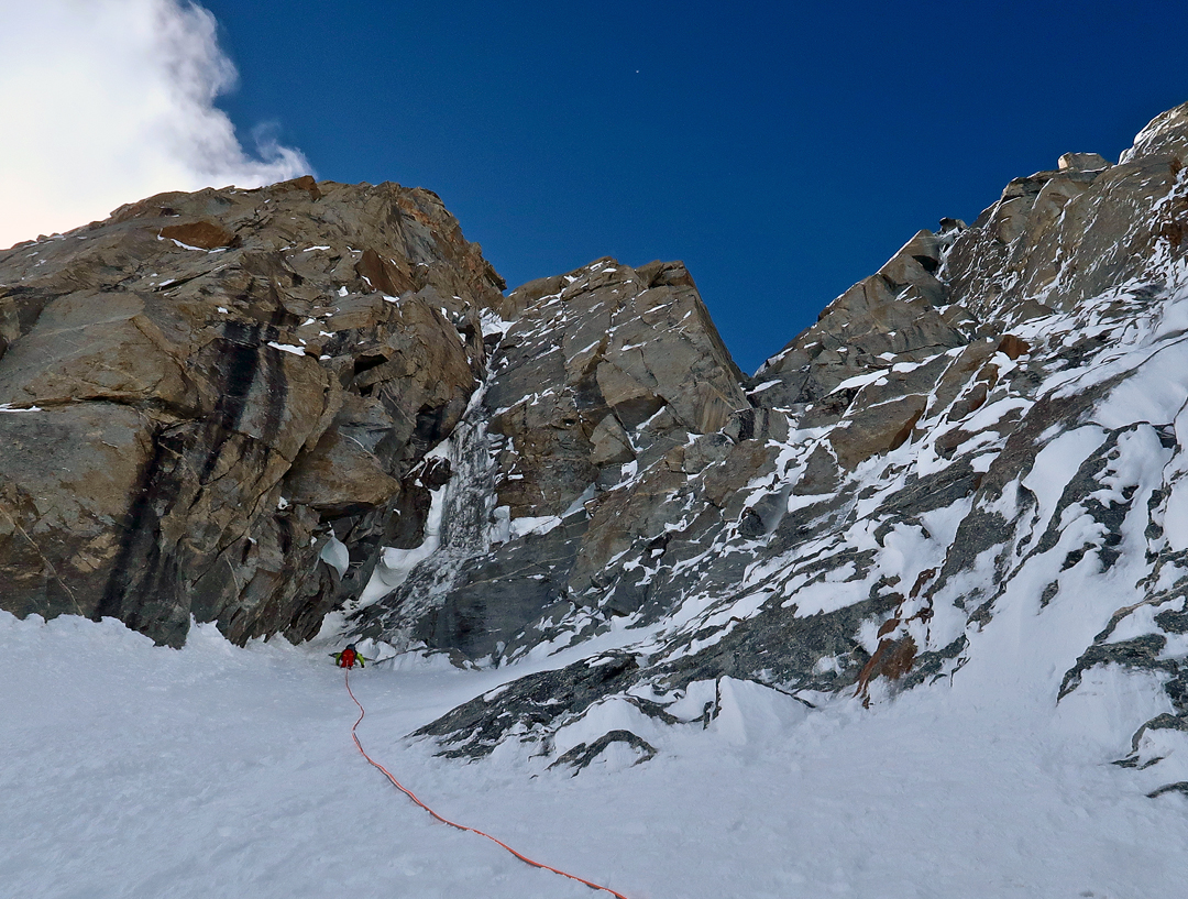 At the top of the snowfield below the start of the difficulties on the north face of Risht Peak.