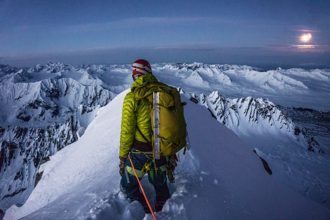 Thomas Eaves looking east from the summit of Mt. Katherine (ca 8,300') after he and Zach Lovell made the peak's first known ascent in May 2019, via the southwest ridge. The two climbed at night for good conditions and summited under a bright moon, leading to the route's name: Moonwalk (III 60˚ snow).
