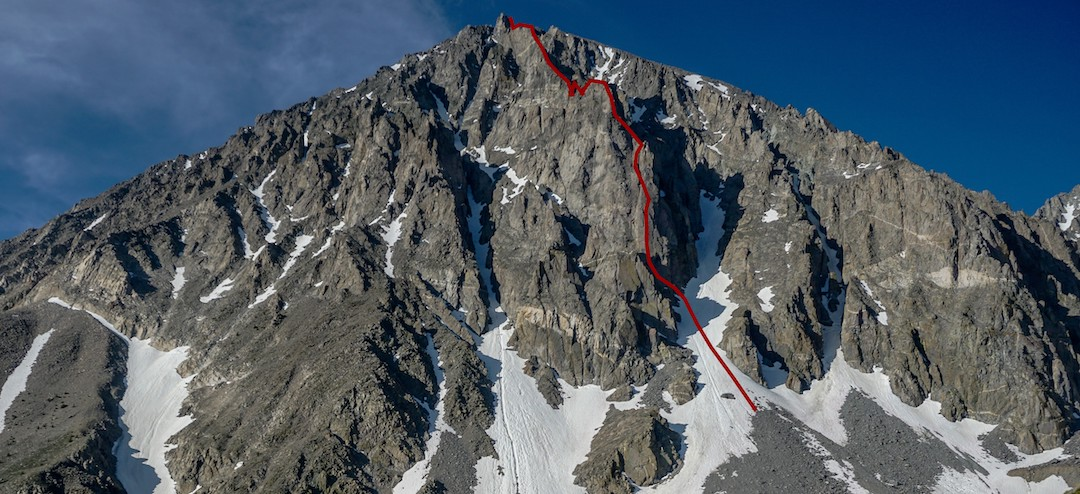 The complex north face of Birch Mountain (13,608') and the line of Mutually Assured Choss (V 5.10-) from below.