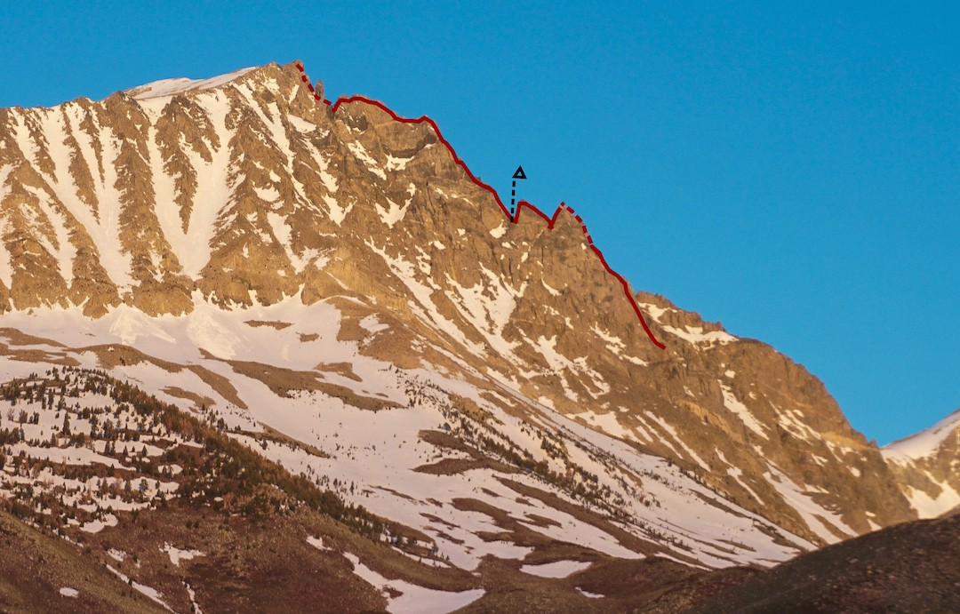 The north ridge of Birch Mountain (13,608') viewed from the east, with the line of Mutually Assured Choss (V 5.10-) and the 2019 team's bivy site indicated.