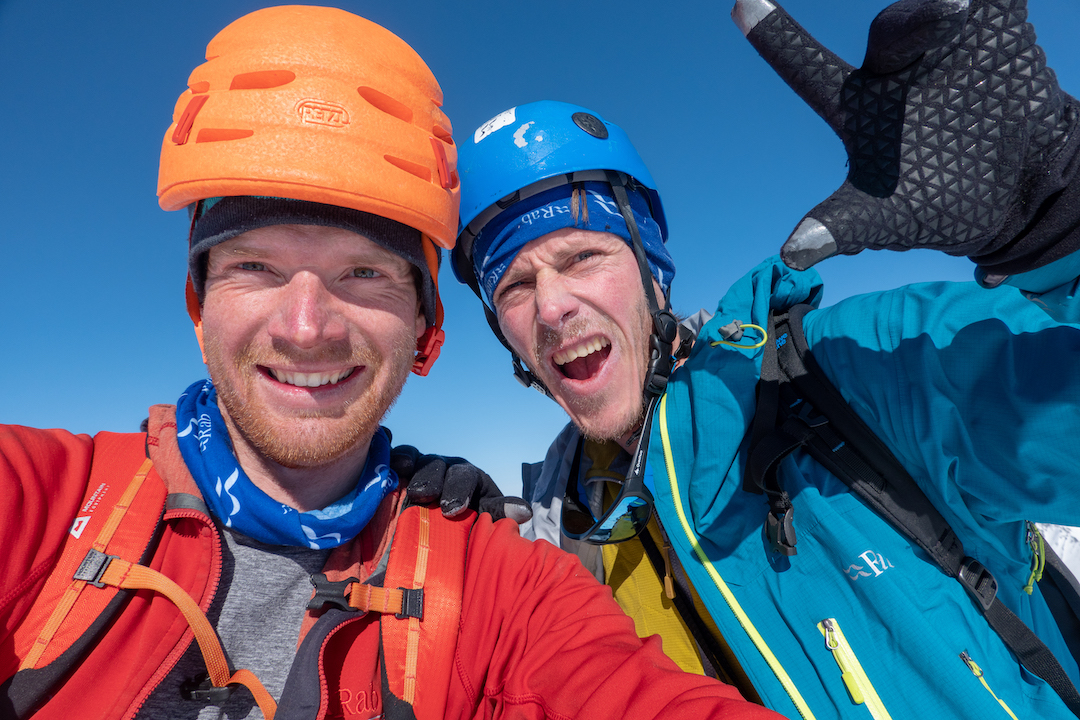 Bas Visscher and Niek de Jonge on the summit after making the first ascent of the South Couloir on Peak 8,910', which they suggested naming Tantalus.