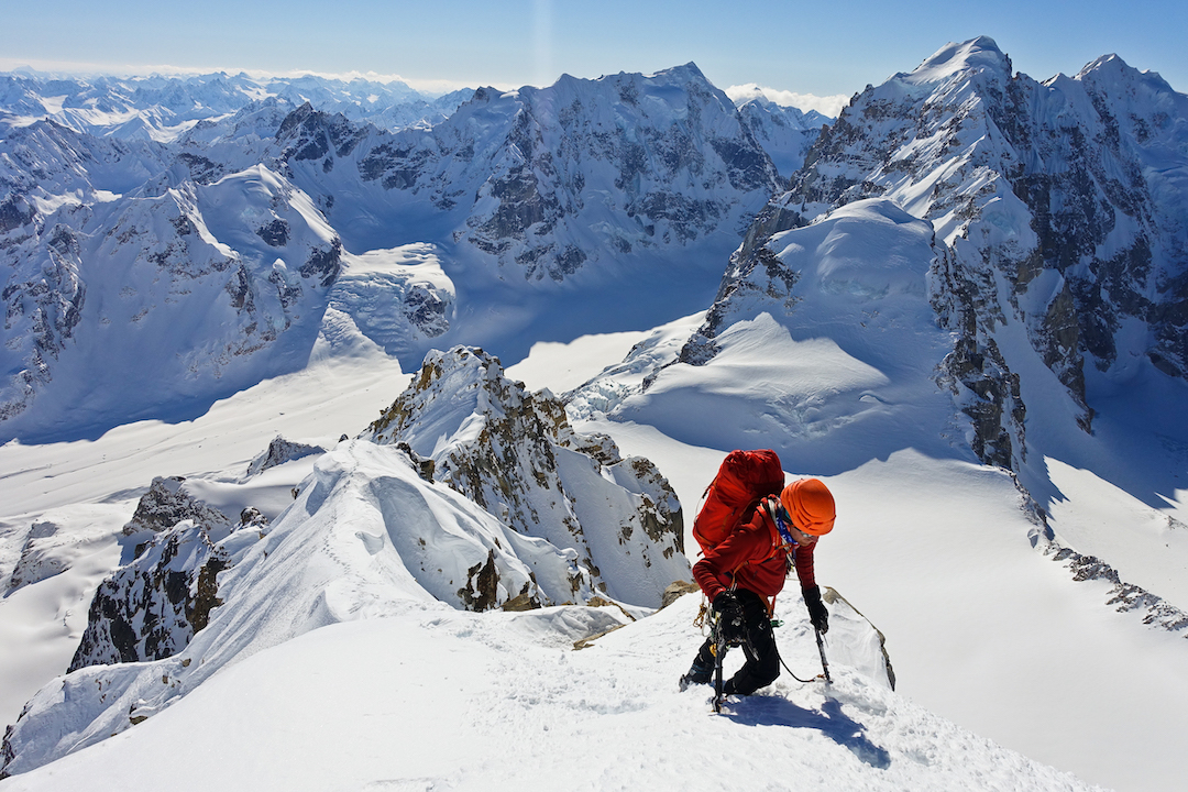 Bas Visscher near the summit of Tantalus (Peak 8,910') after making the first ascent of the south couloir. Behind him is the Obelisk (left) and Jezebel (right).
