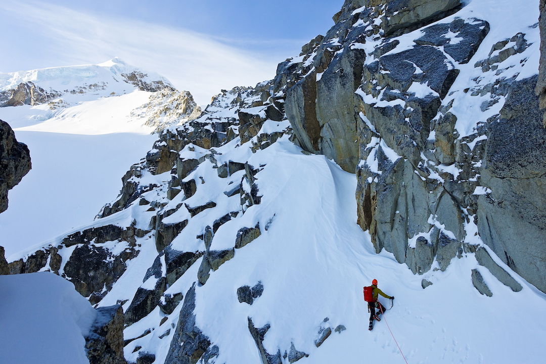 Bas Visscher with a long way to go on the north ridge of Mt. Titanic. The summit is visible in the distance.