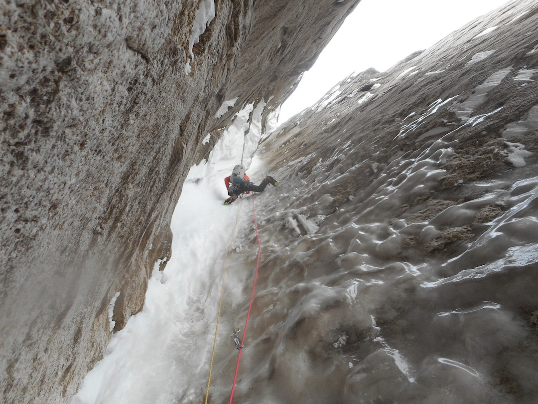 Jackson Marvell leading up an AI6 pitch on the first ice hose, during the first ascent of Ruth Gorge Grinder (5,000', AI6+ M7 A1) on the east face of Mt. Dickey.