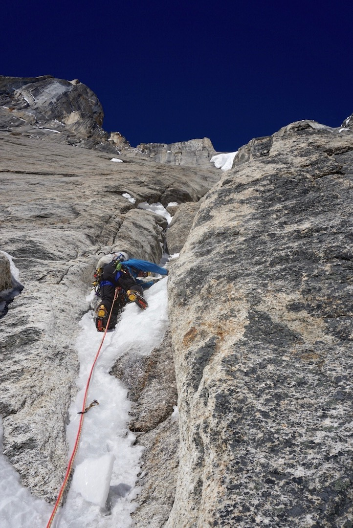Alan Rousseau leading fun ice and mixed terrain in the middle section of Ruth Gorge Grinder (5,000', AI6+ M7 A1). He and Jackson Marvell climbed this new route on the east face of Mt. Dickey in early April 2019.