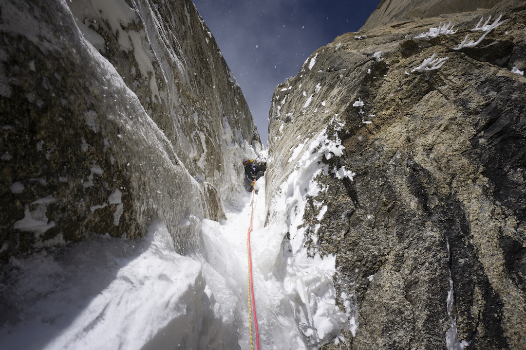 Alan Rousseau climbing one of the final ice pitches before the low-angle upper slopes during the first ascent of Ruth Gorge Grinder (5,000', AI6+ M7 A1).