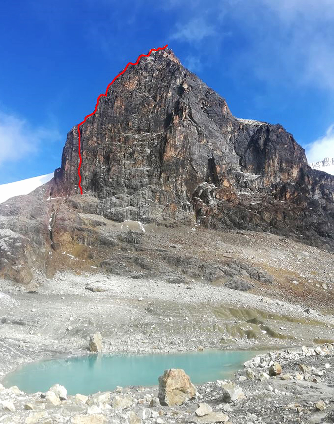 The southeast face of Charquini with the line of Le Chat. For other routes on the east face see AAJ 2019.