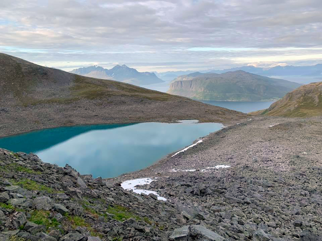 Looking northeast from Skjelettinden over the lake of Blåvannet toward the island of Kågen (distant left) and the peninsula of Vardfjellet.