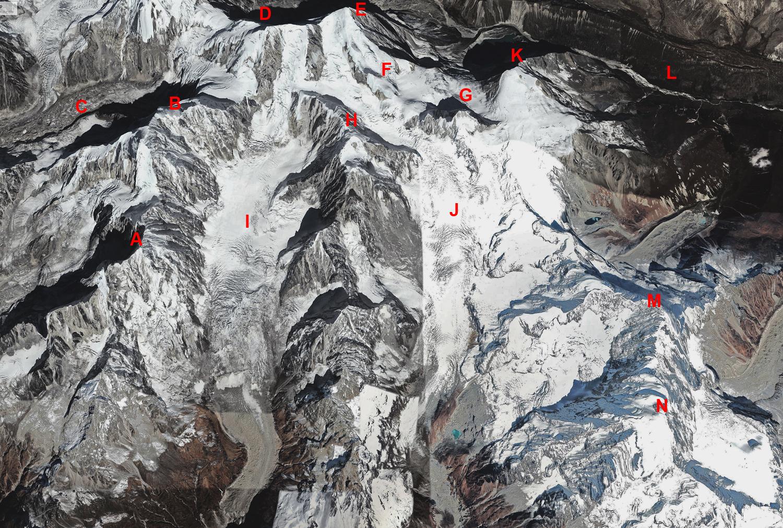 The Jugal Himal. (A) Peak 6,563m. (B) Dorje Lhakpa (6,966m). (C) Langshisha Glacier. (D) Leonpo Gang (6,979m). (E) Leonpo Gang East (6,733m). (F) Gumba Chuli (6,256m). (G) Gyalsten (6,151m). (H) Peak 6,591m. (I) Dorje Lhakpa Glacier. (J) Jugal Glacier. (K) Tsha Tung (5,995m). (L) Nyanang Phu Valley. (M) Yangri (6,535m). (N) Phurbi Chhyachu (6,637m).