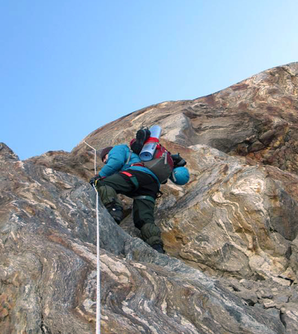 Jumaring the lower rock wall on the ascent to advanced base at Nyang Kharka.