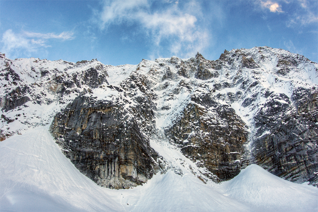The southeast face of Chhopa Bamare. The route of the first ascent climbed the couloir that slants right (hidden in the lower section), beginning from the top of the obvious snow cone at far left.