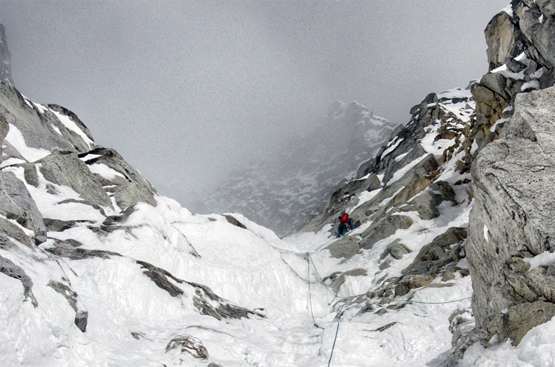 John Kelley climbing mixed ground on the southeast face of Chhopa Bamare.