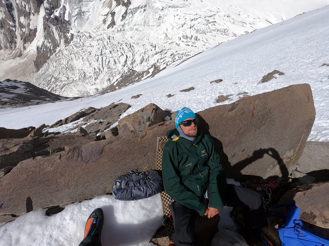 Martin Sieberer at the bivouac site on the southeast ridge on the Black Tooth, having climbed the face below falling to the Dre Glacier.