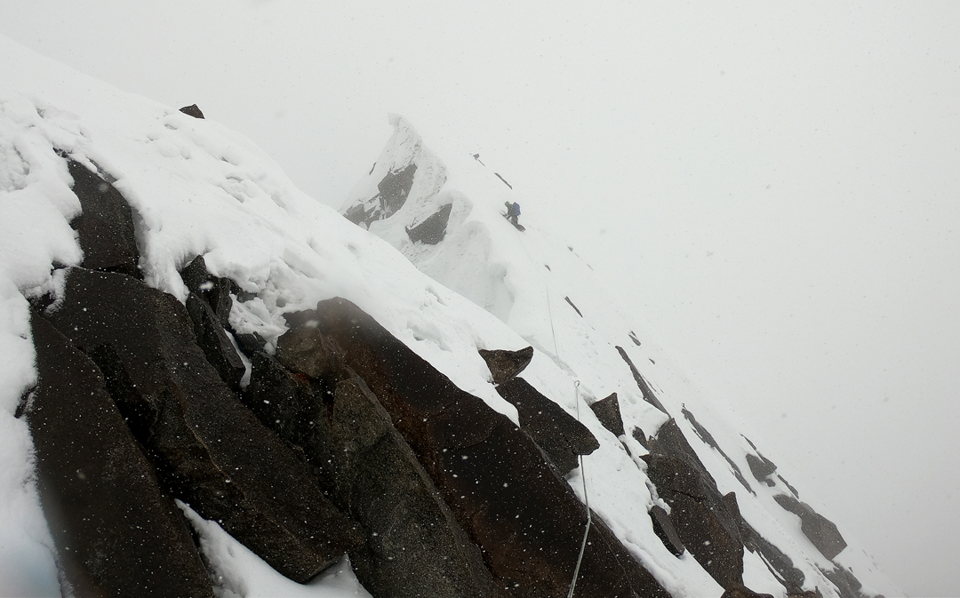 Climbing through bad weather on summit day on the Black Tooth.