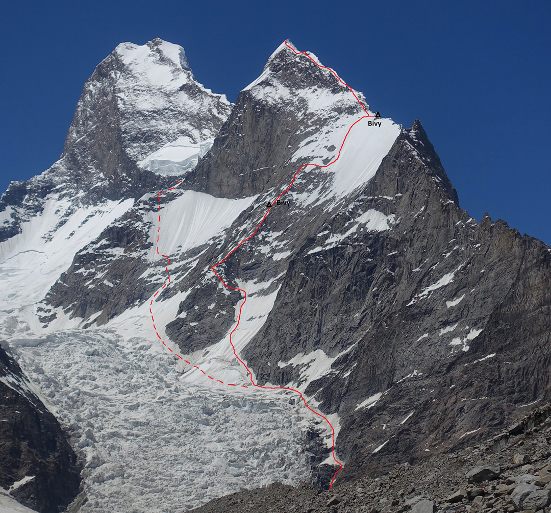 Muztagh Tower (7,284m, top left) and its southeast ridge, with a high point on the Black Tooth (6,719m). The solid line, with the two marked bivouac sites, is the line of ascent to Black Tooth followed by Simon Messner and Martin Sieberer in 2019. Their descent went down to the col between the Tooth and Muztagh Tower (hidden), descended south to the right end of the conspicuous serac barrier, then continued along the dashed line to regain the glacier approach. In 2016, Felix Berg and Matthias Konig reached the lower southeast ridge from the opposite side and climbed to the small tower (6,000m) visible at the top of the rock section, before escaping down the south face.