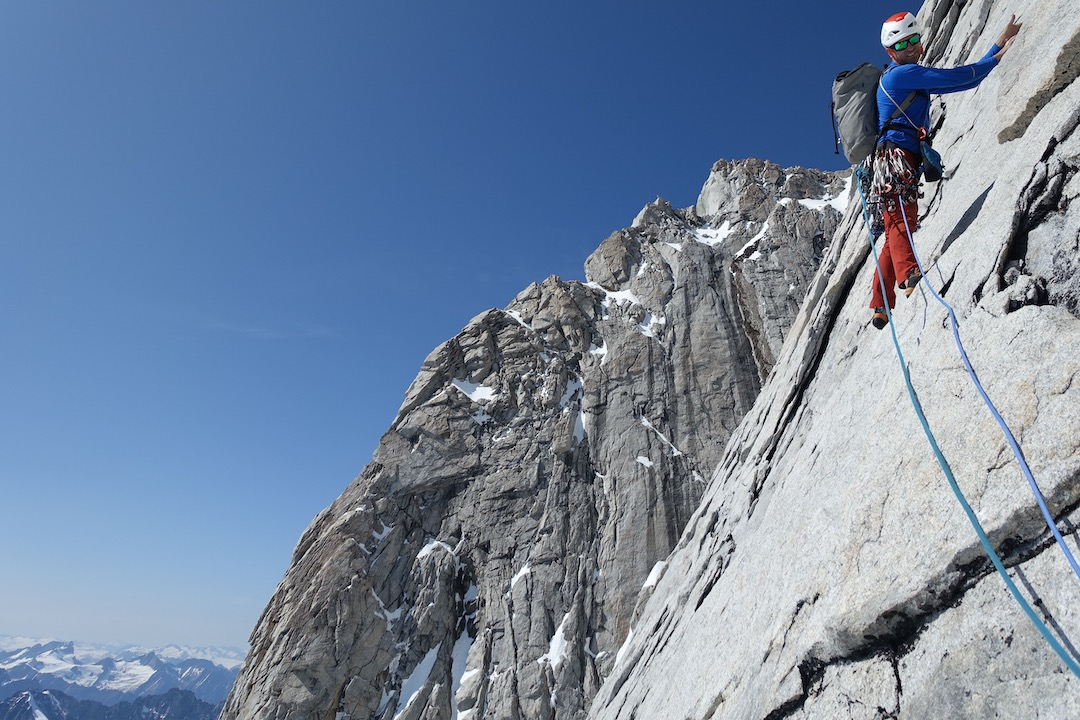 Paul McSorley starting up the fifth pitch of Peaceful Warrior (750m, TD- 5.11a) on the rightmost buttress of Mt. Combatant's southwest face.
