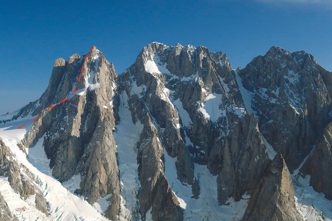 The Tiedemann Group from left to right: Combatant, Tiedemann, and Asperity. Peaceful Warrior (red line, 750m, TD- 5.11a) starts on easy snow then climbs the left side of a clean rock buttress to easier ground, finishing on Kshatrya.