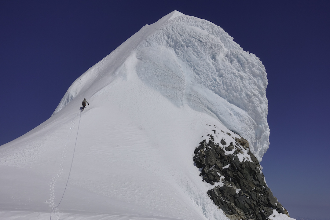 Ian Welsted approaching the Northwest Summit of Mt. Waddington during his and Simon Richardson's climb of the complete west ridge in August 2019.